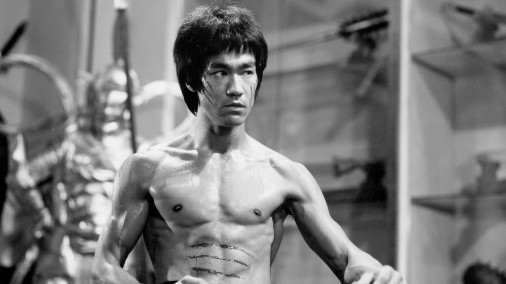Bruce Lee poses