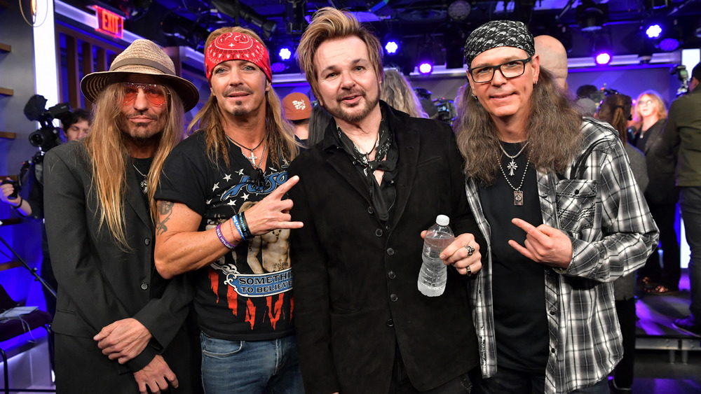 Poison members CC DeVille, Bret Michaels, RikkI Rockett, and Bobby Dall (L-R) pose at an event in 2019.