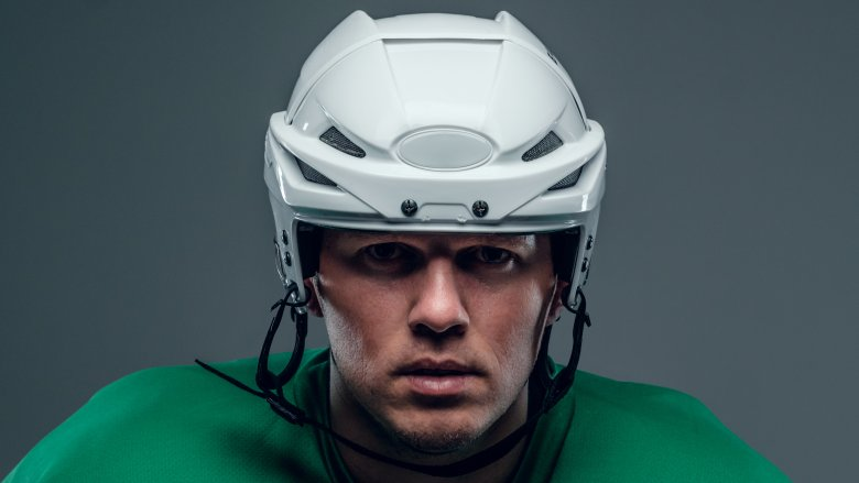 Hockey player with helmet