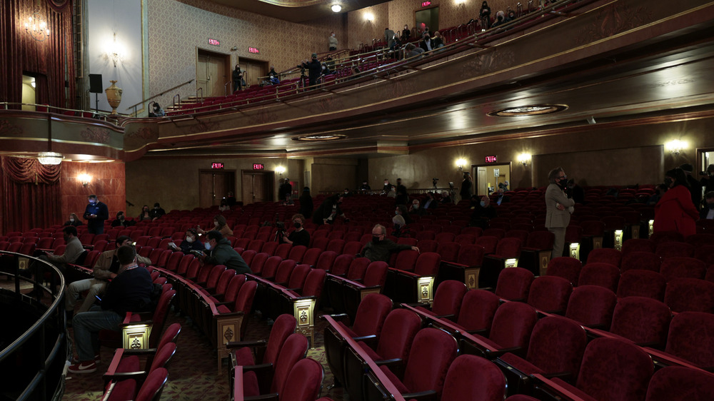 People seated in Broadway theater