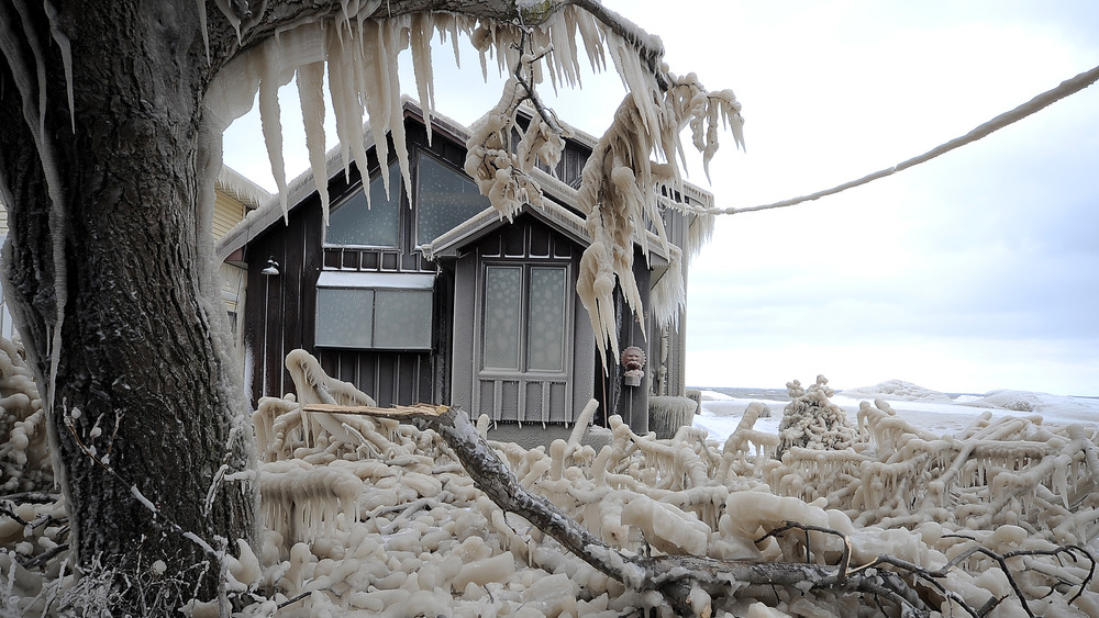 House covered in icicles in cold weather