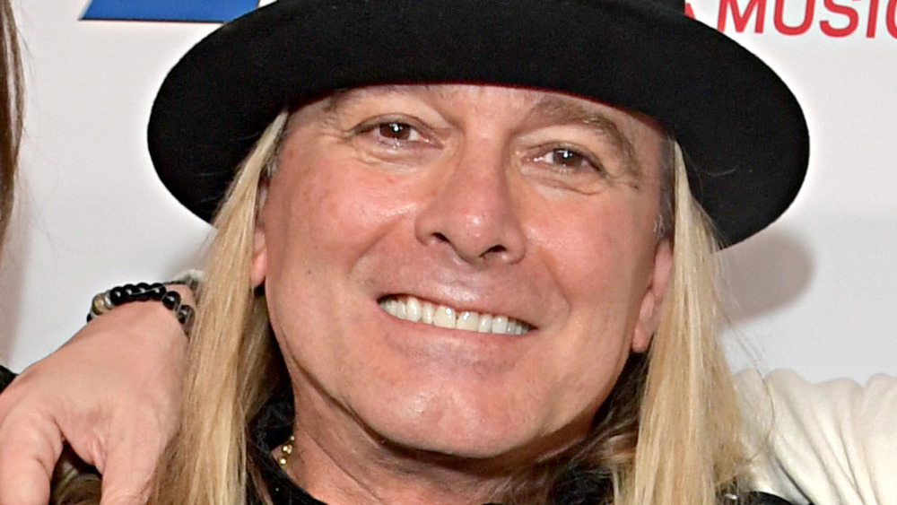 Robin Zander in a top hat