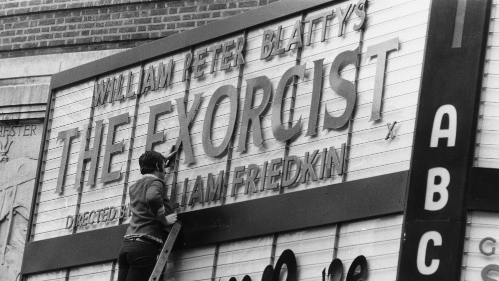 Man creating The Exorcist movie marquee
