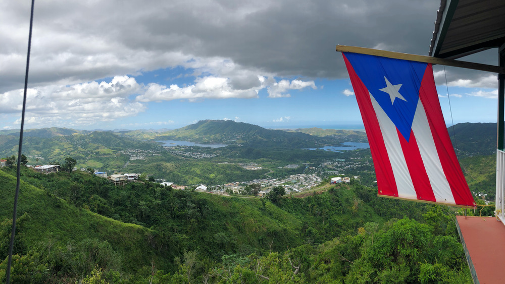 Puerto Rico mountains and flag