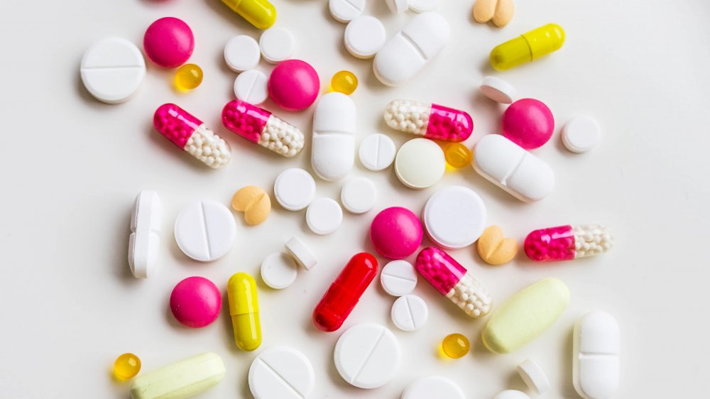 Assorted pharmaceutical medicine pills, tablets and capsules.