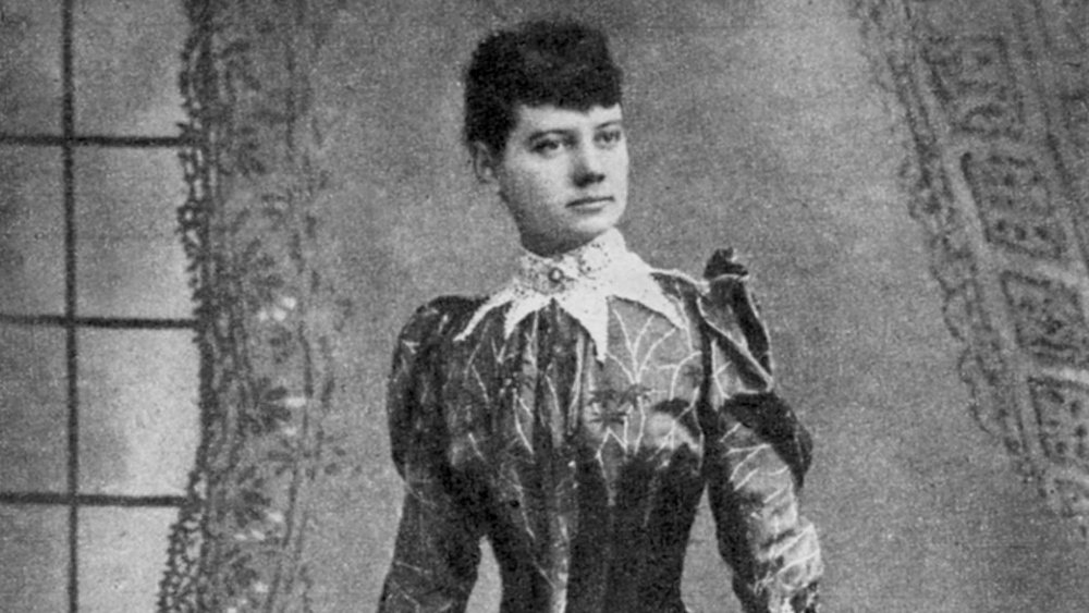 Nellie Bly standing