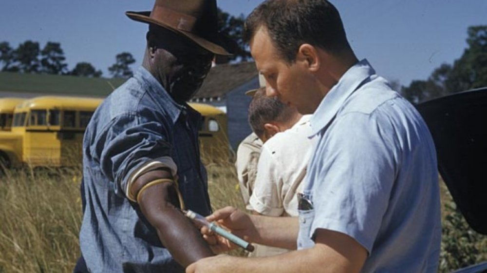 doctor injecting Tuskegee patient