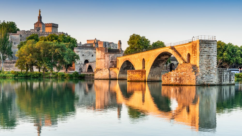Avignon Bridge with Popes Palace and Rhone River at sunrise, Pont Saint-Benezet, Provence, France.
