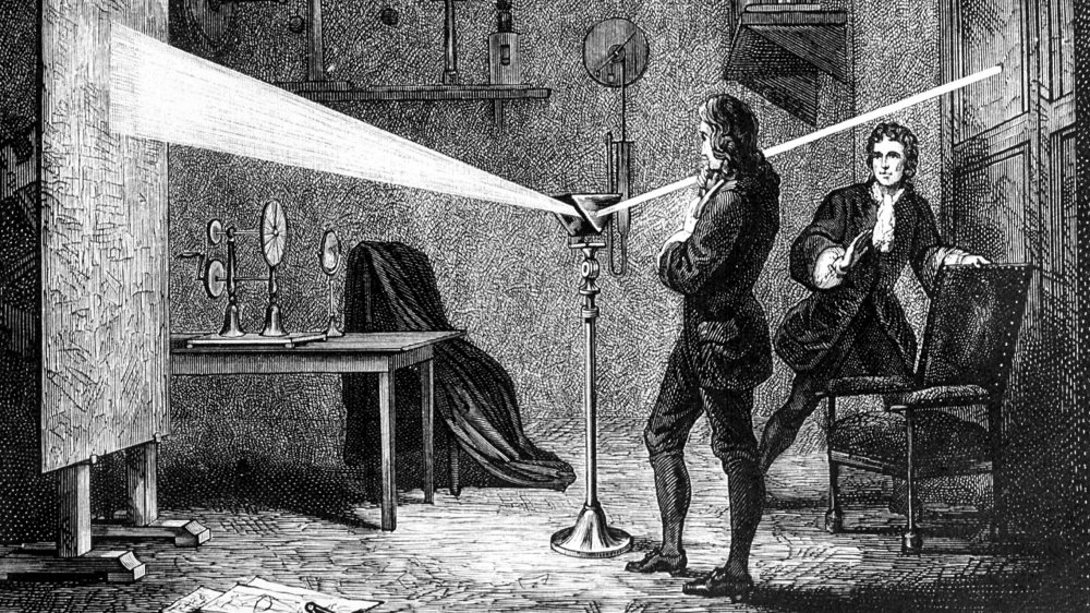 Isaac Newton experimenting with a prism