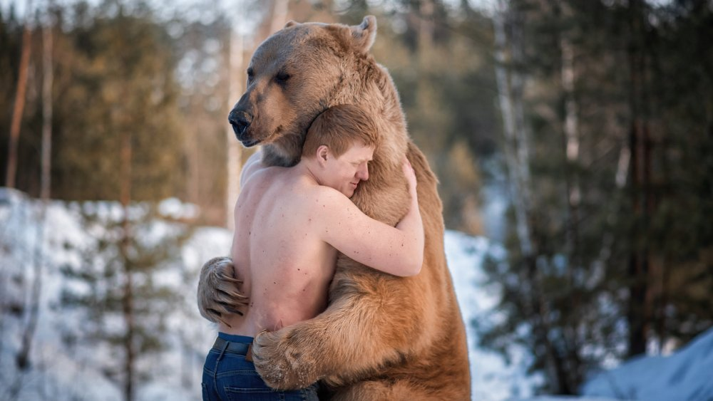 Man and bear hug