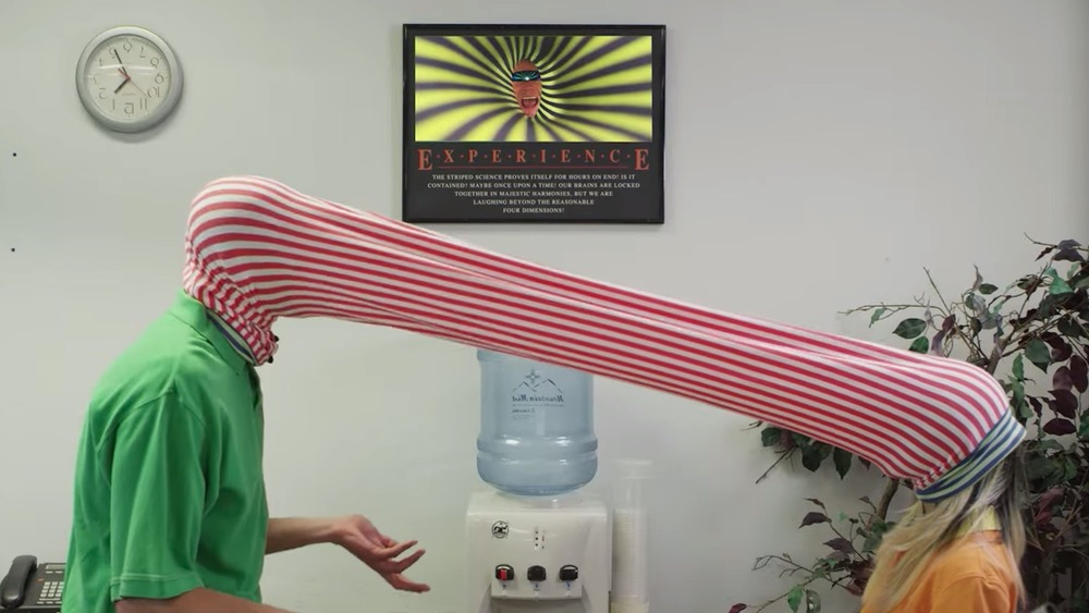 people connected with red and white striped tube