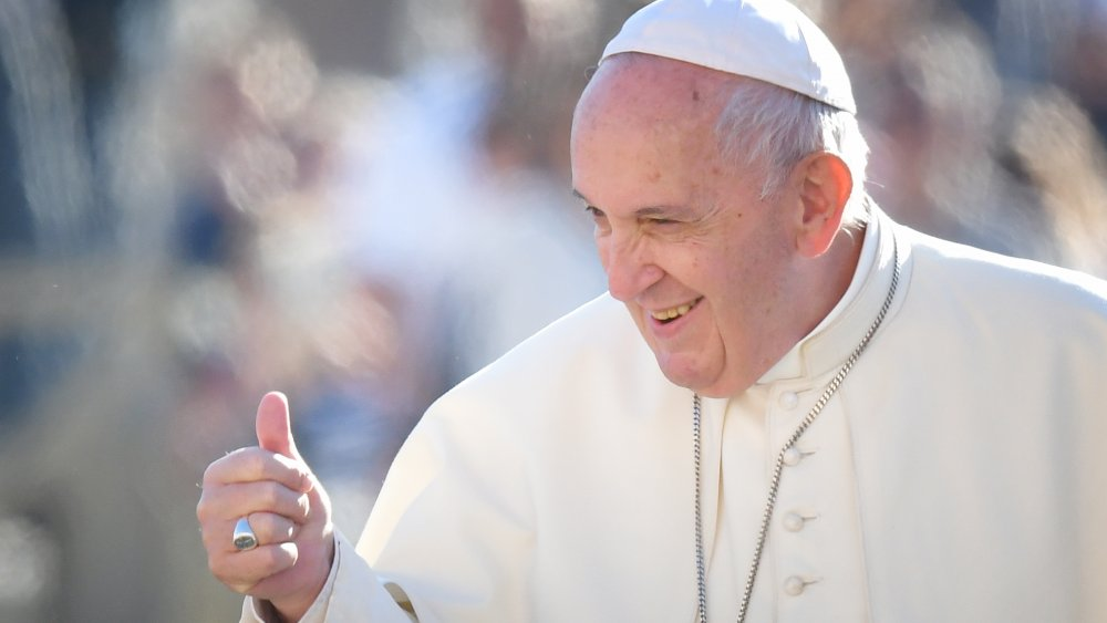 Pope Francis gives a thumbs-up