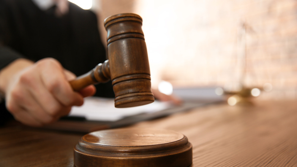 Judge using gavel in courtroom
