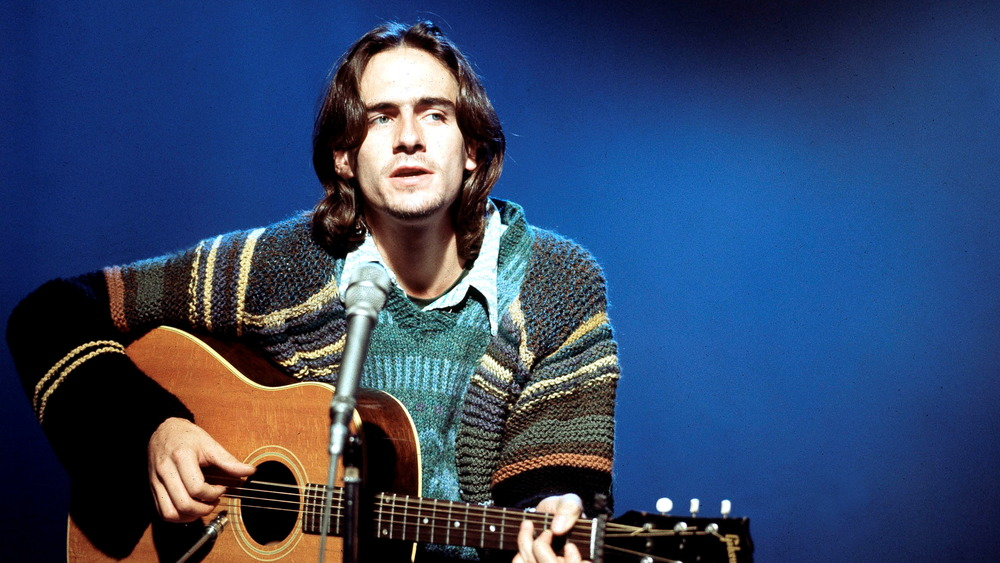 Long-haired James Taylor on stage in 1971