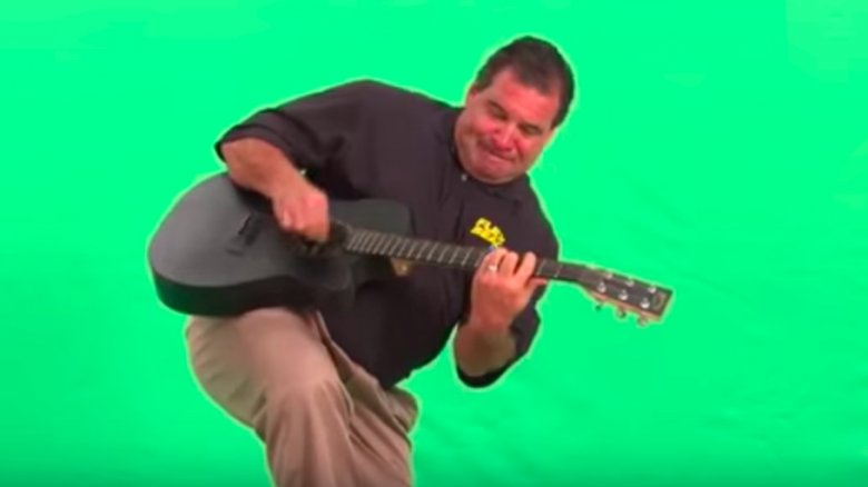 Phil Swift playing guitar