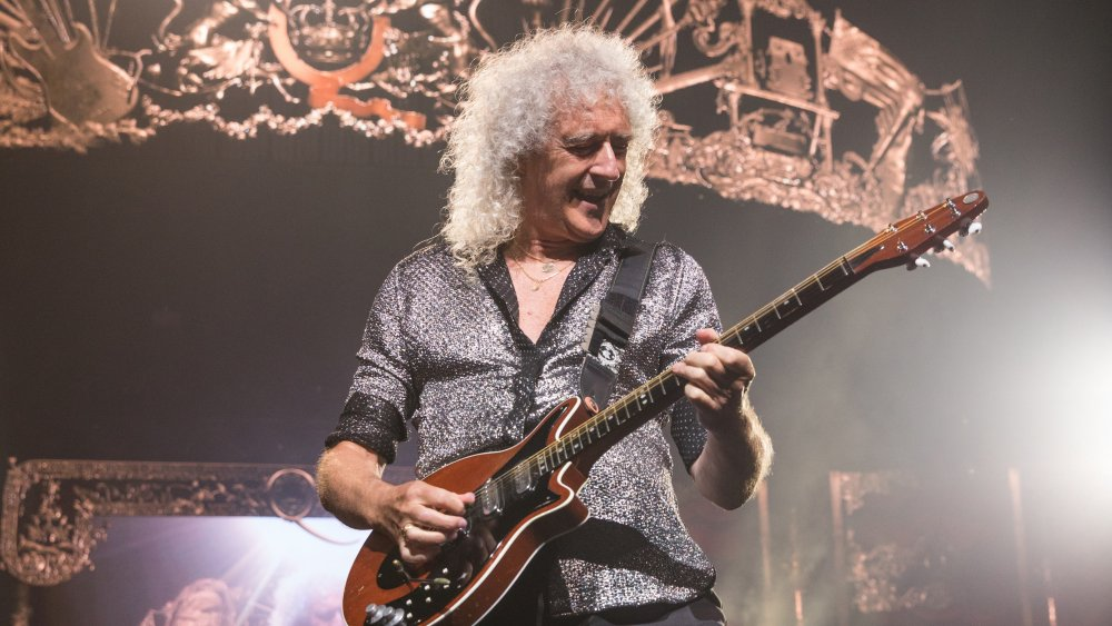 Brian May onstage in 2019