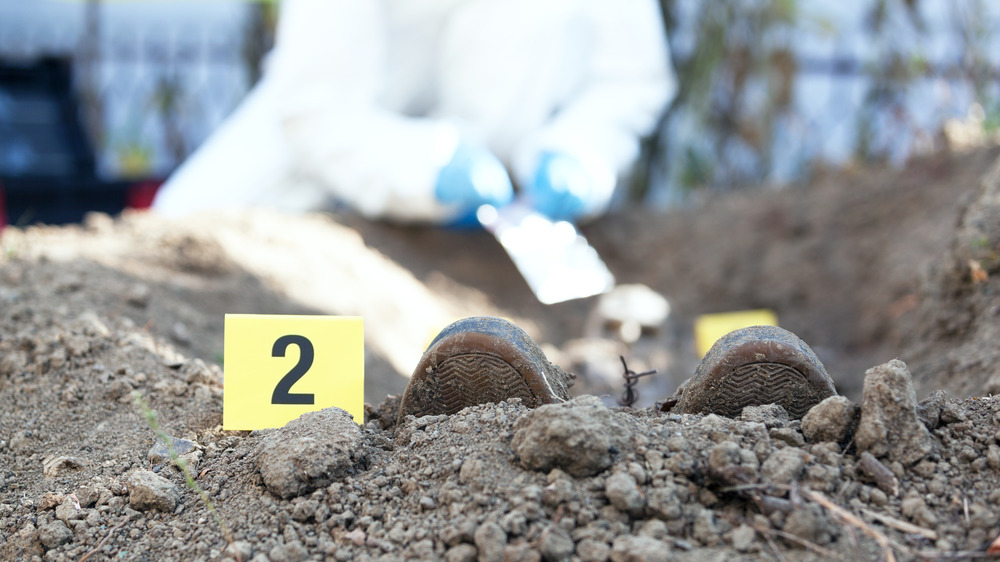 Police exhume a body from the ground