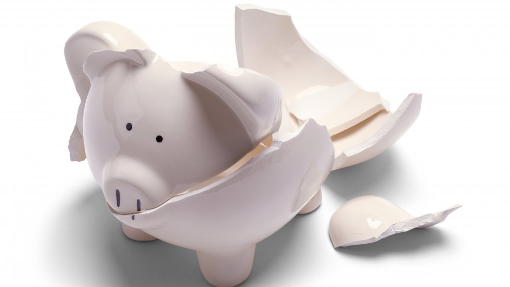 A piggy bank broken into with extreme violence