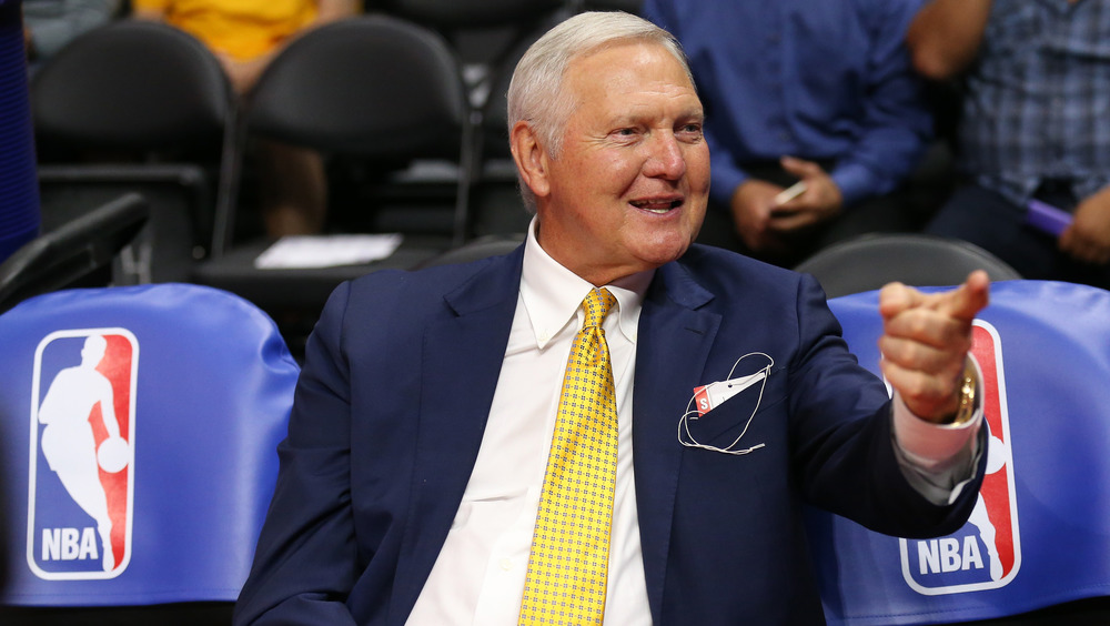 Jerry West sitting with finger pointing