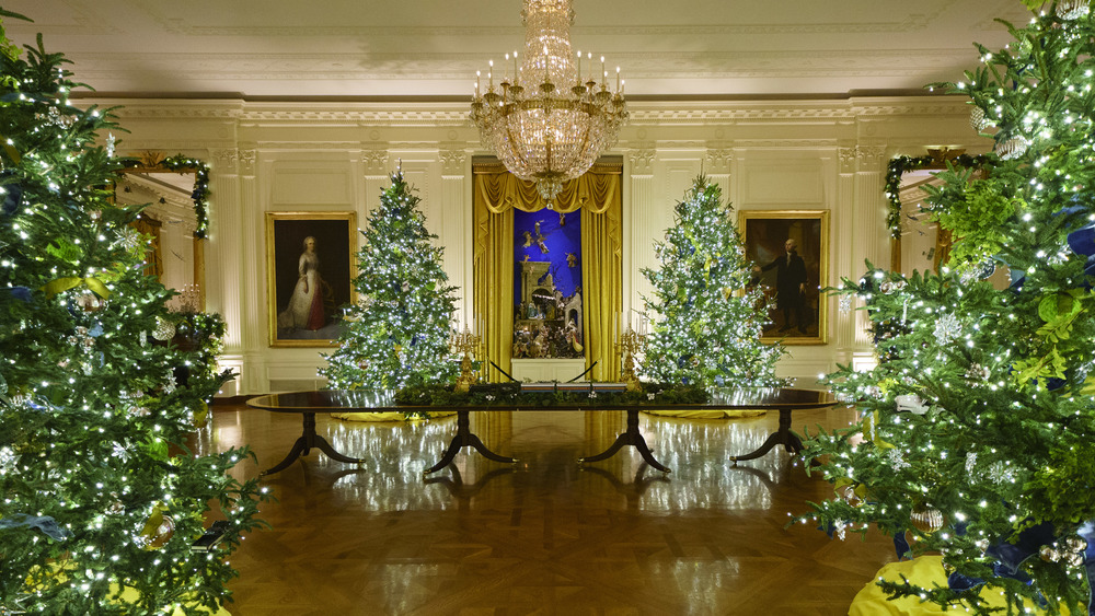 Christmas decorations are displayed in the East Room of the White House