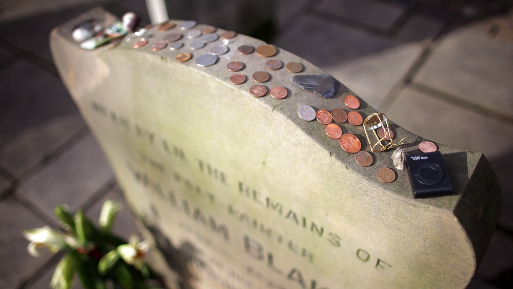 Coins on a headstone